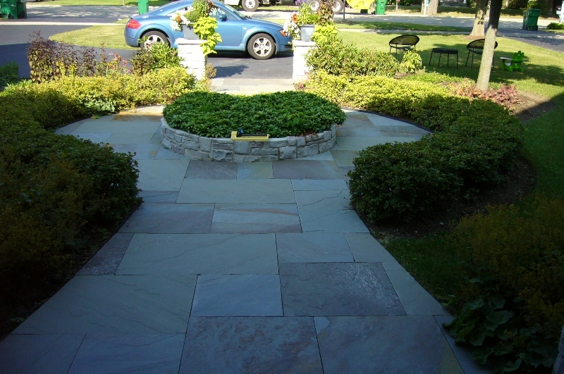 Stone paver walk ways with planters in the middle