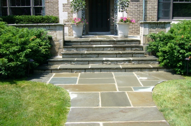 Correct gravel and nice plants to frame up entryway steps pavers