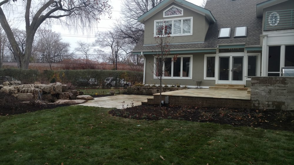 Multi-level Flagstone Patio Connecting Home with Outdoor Water Fountain