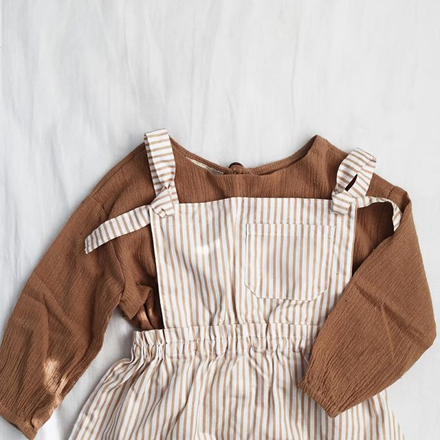 packaging orders and had to share this outfit perfection 😍 almost too cute to wear. almost 😉 these pinafores will be making a comeback this spring in some fresh new colors and fabrics 🙌🏼