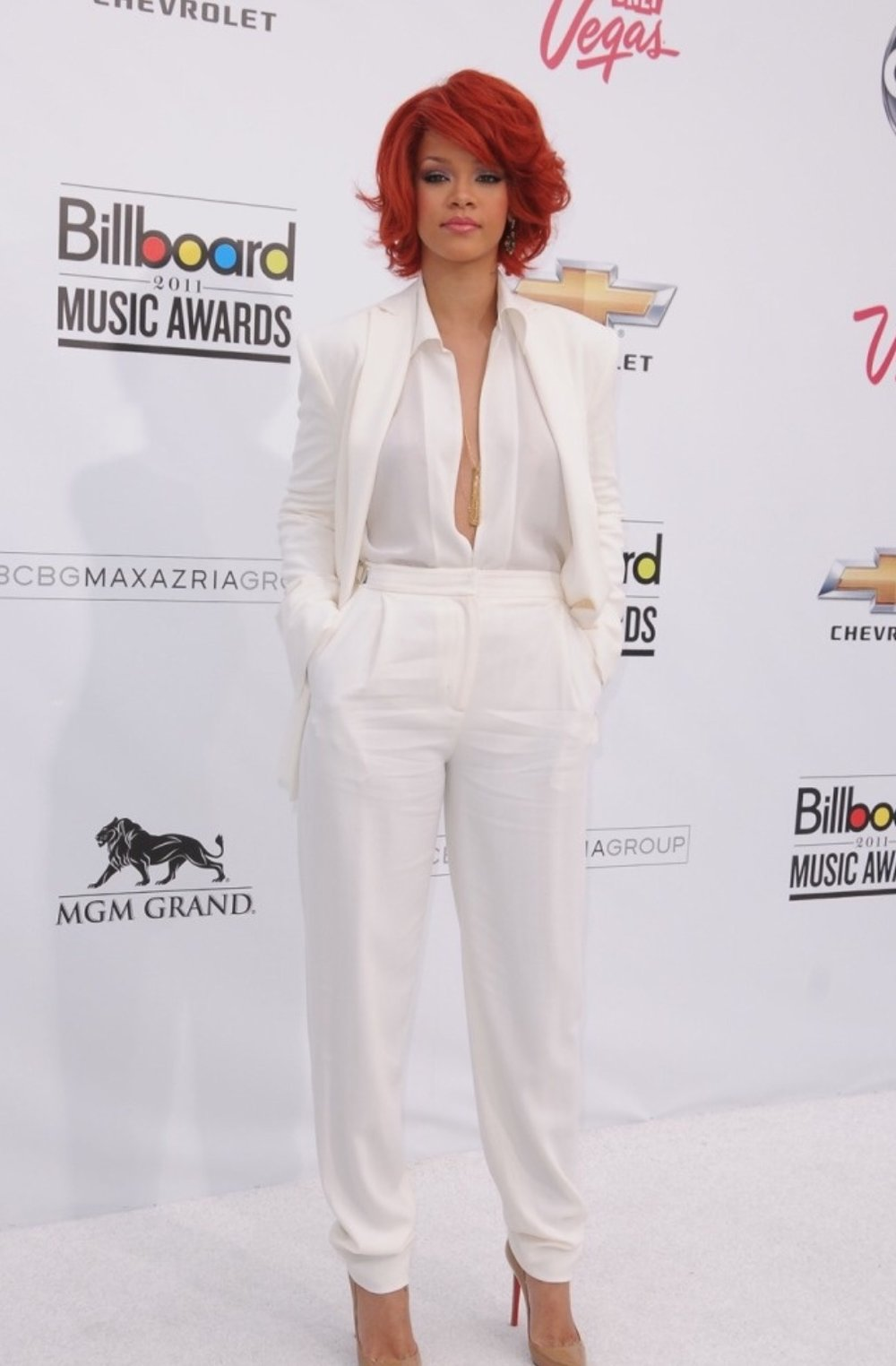 Rihanna is certainly a celebrity known for making dress pants more fashionable. You can easily pick up dress pants almost at any retail store such as: Marshalls,Burlington Coat Factory, Forever 21, and H&M.  prices usually range on it's designer and quality. It can be as low as $10.00!