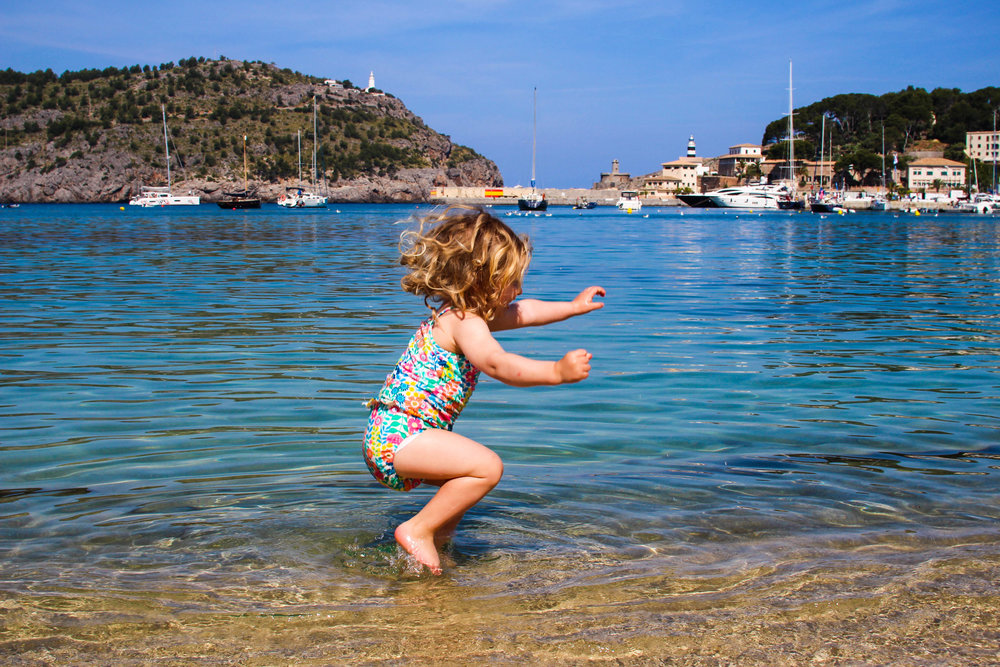 Jumping in the crystal clear waters of Port Soller