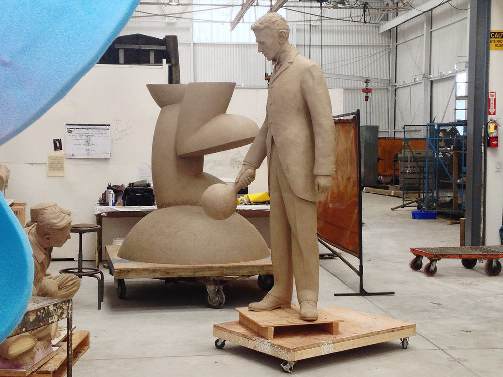 Full sized clay Nikola Tesla in the mold-making room at Artworks Foundry in Berkeley California ready to get it's mold the first step in the lost wax casting process.