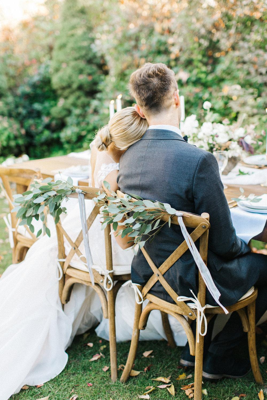Mila Adams - Kentucky Utah Wedding Florist  - Wedding chair bride and groom greenery