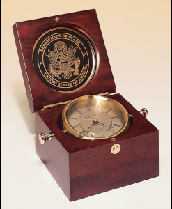 Captains Clock  Captain's clock in hand-rubbed mahogany-finish case, solid brass clock housing. Price of $259.00 does not include engraving. Engraving is the greater of $24 or 30¢ per character. Overall size is 5½ x 5½ x 3¾. Lifetime guaranteed movement