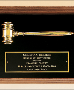 Gold Gavel in Walnut Shadowbox   Gold Electroplated Gavel in Walnut Shadowbox with Black Velour background and black brass engraving plate.  Measures 10″ x 13″. Can only be displayed in landscape orientation.  Price of $130.00 does not include engraving.