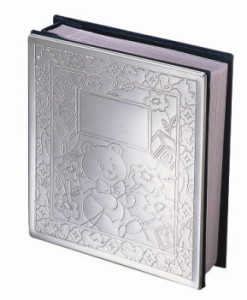 Chrome Teddy Bear Baby Album   Chrome album holds 100 4x6 photos and has a cute teddy bear design on front. What's nice about chrome is that it doesn't tarnish and therefore doesn't require polishing.  Price of $30.00 does not include engraving.