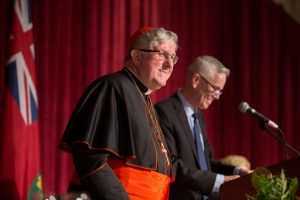 Cardinal Collins and USMC President and Vice-Chancellor David Mulroney share the stage (The Archdiocese of Toronto).