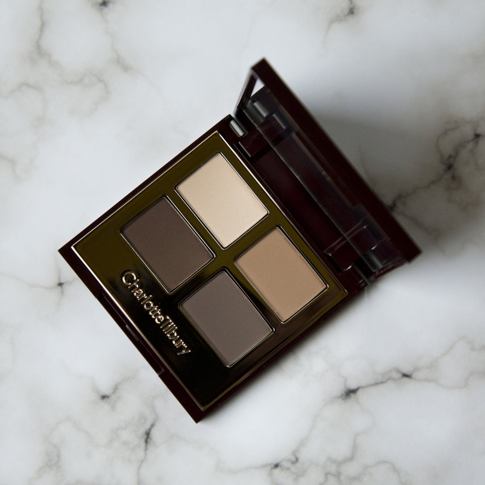 Charlotte Tilbury Luxury Palette in The Sophisticate   The pressed powder was just the tip of the Charlotte Tilbury iceberg for me because this is the brand I ended up going in on. I had been dying to try out her Luxury Palettes since the color stories are gorgeous and decided now was the time. I ended up buying two eye quads and an eye pencil at Beautylish since shipping from Feel Unique takes too long and I am incredibly impatient. I will note that I made the Feel Unique purchase and the Beautylish purchase on the same day because right after buying the powder I made up my mind about trying more of her products and was eager to get to it. I chose The Sophisticate palette because I knew it was one that I would be able to get my use out of since it is neutral. The three darker tones are matte and the lighter shade is more of a satin. This is the perfect every day neutral eyeshadow palette and I think the colors are the perfect balance of not too warm and not too cool. The formula is also amazing and very unique. They have the least amount of fallout that I've ever seen in an eyeshadow and blend like a dream. This is my favorite eyeshadow formula that I've come across thus far because of how easy the shadows are to work with. It is rather expensive for only four shadows coming in at $53 but this is a palette that I really like and can see myself using very frequently. If you want to see this palette in action you can watch Charlotte's video creating The Sophisticate look   here  .