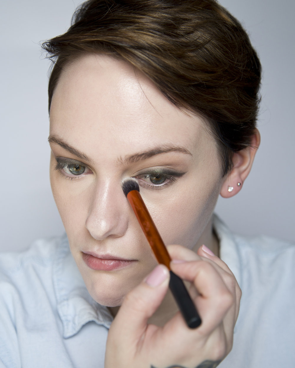 Before setting my concealer I like to go in with a small brush or a q-tip and pick up and blend out some of the concealer that settles in my under eye creases. Some people like to set immediately after applying concealer to avoid creasing but I find that I'm less likely to crease later in the day if I let it crease before and then pick up the extra product that settled before setting the area.