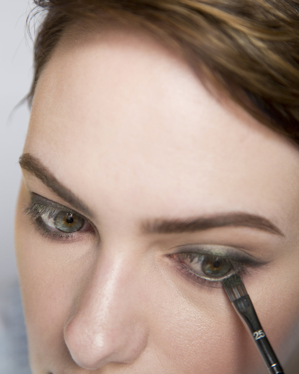 More green eyeshadow! I went back in with the green shade on a flat liner brush (could also use an angled liner brush) just under the lashes to bring the green down a little bit and blend it into the mauves to marry the shadows together.