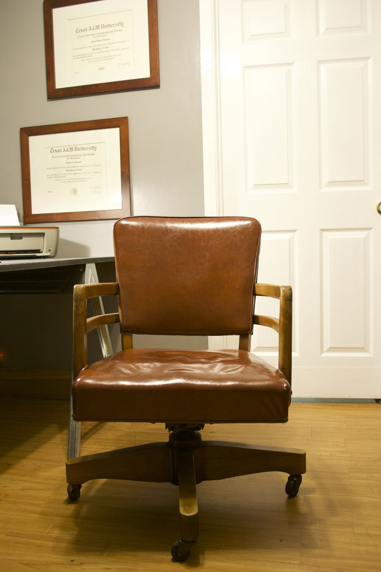 """The favorite part of our current """"office"""" is this old, worn in retro chair that we purchased from our next door neighbor. It does a sturdy job of keeping us on task!"""