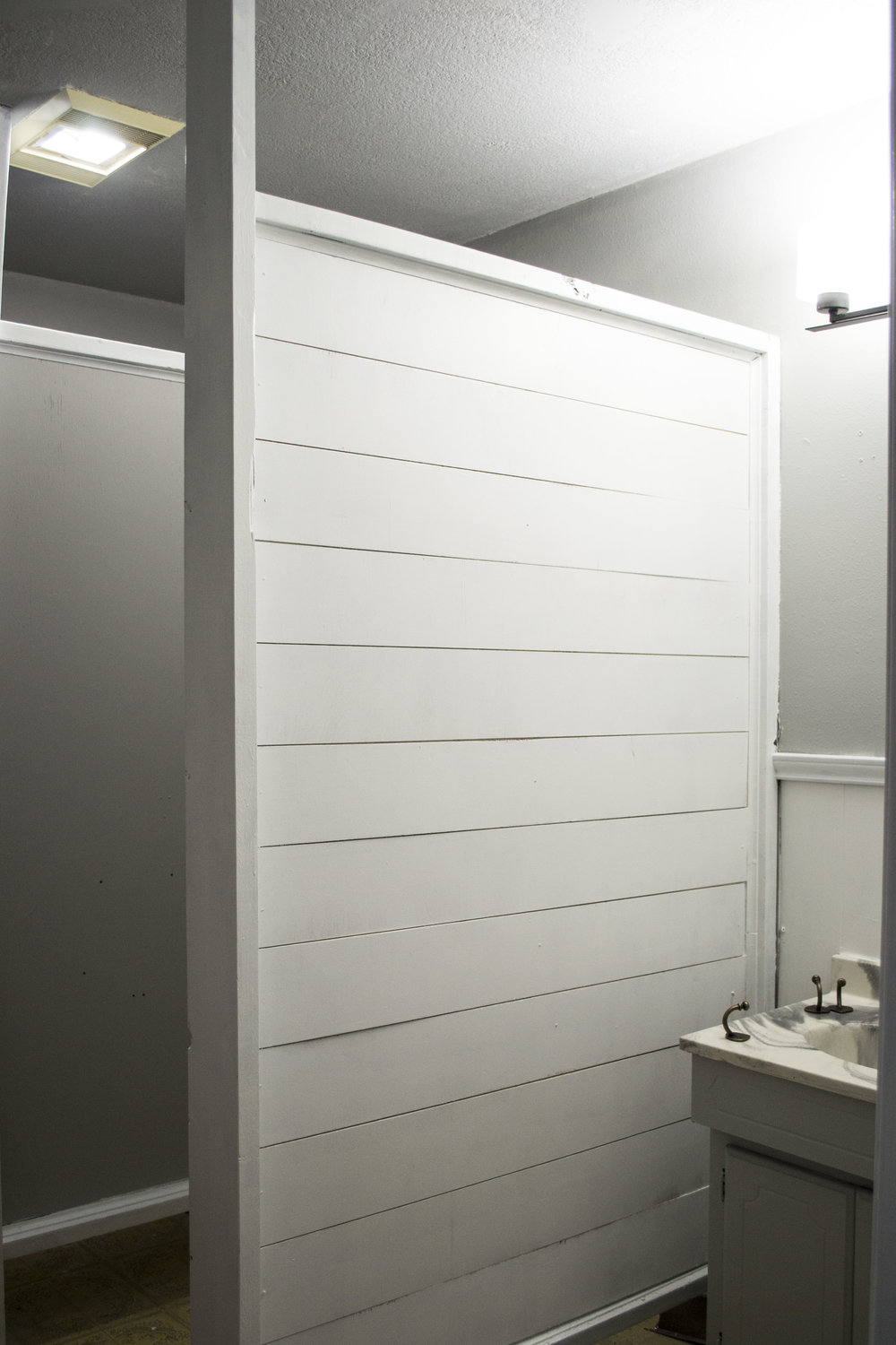 This is the shiplap panel you see right as you enter the bathroom. Once we finished the rest of the bathroom, the whole space appeared more refreshed and polished.