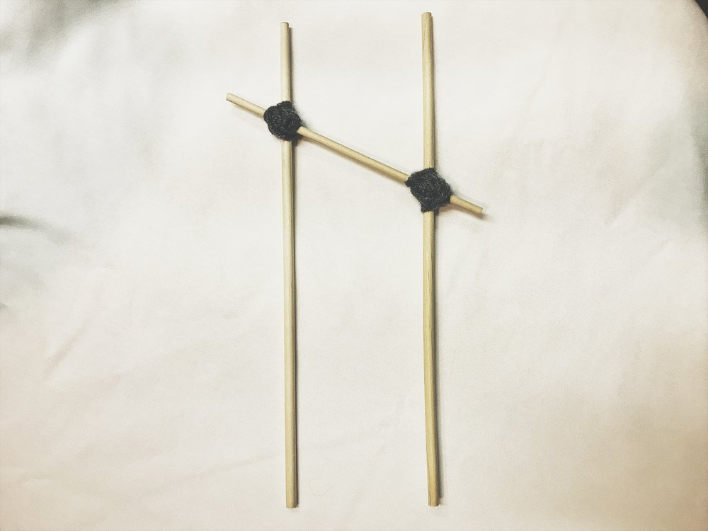 Materials: at least 2 dowel rods (# depends on letter), hot glue, string