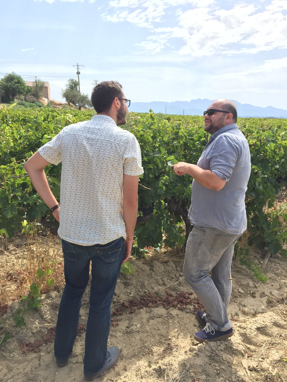 Wilfried and me in his fields, discussing harvest