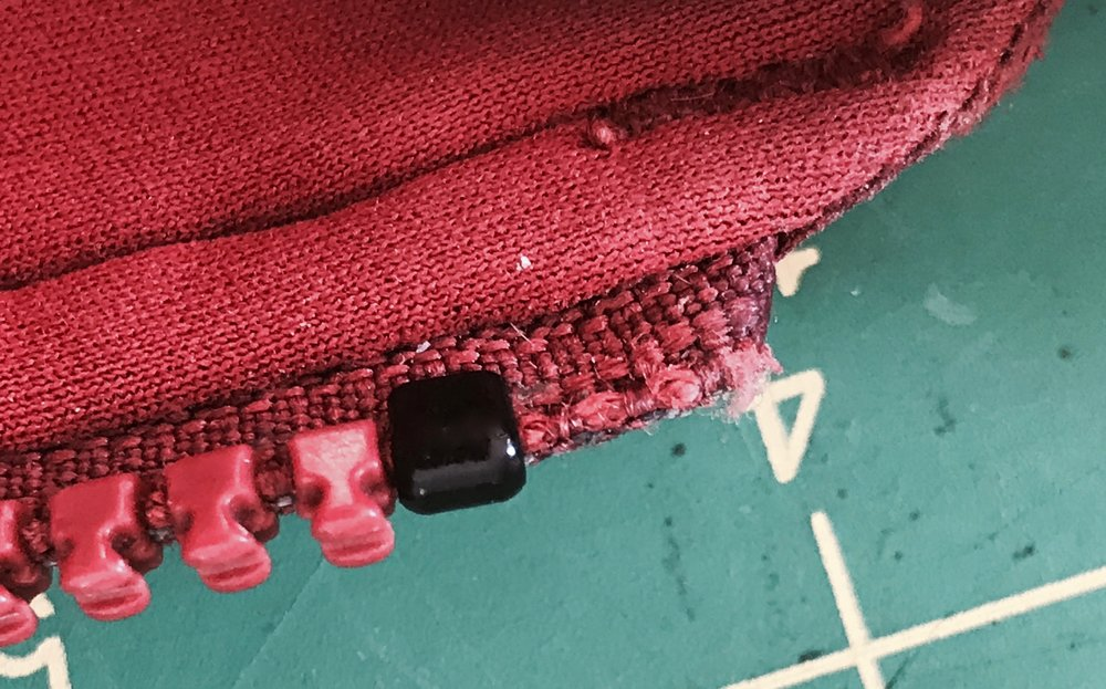 A new top stop will keep the replacement slider on the zipper chain.