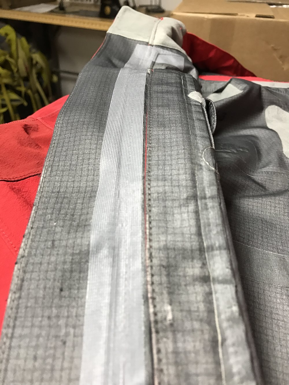 After replacing the zipper on this shell, the seam was taped to restore a factory level of waterproofing.