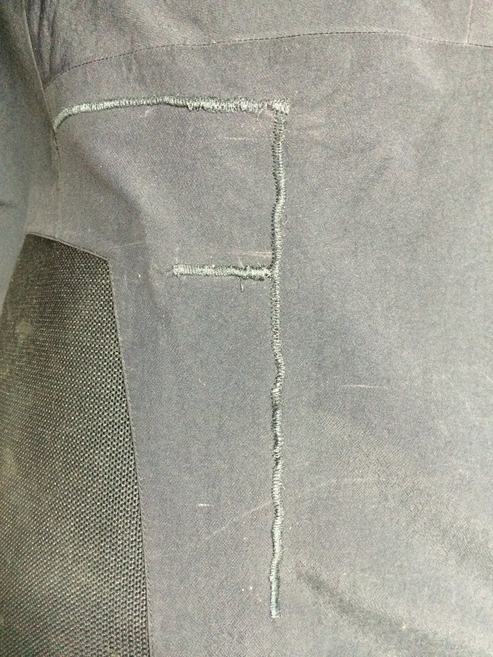 Gore-tex® pants mended after a run in with crampons.