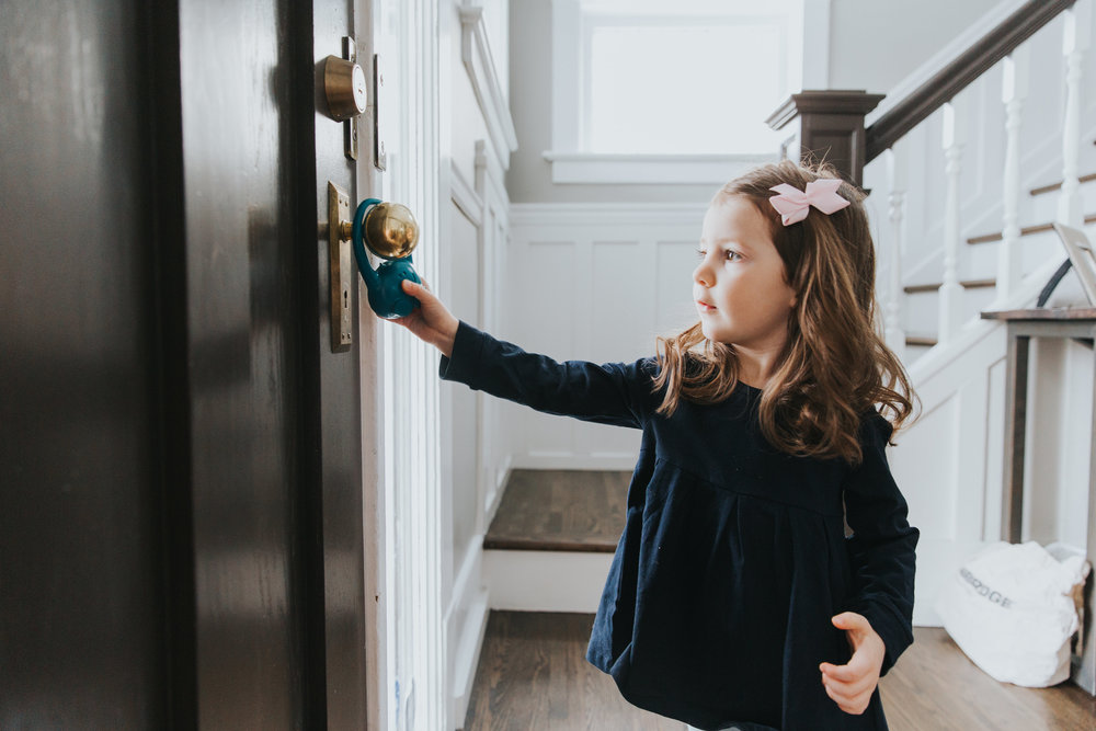 Child proof an interior or exterior door within a home without installing any hardware.