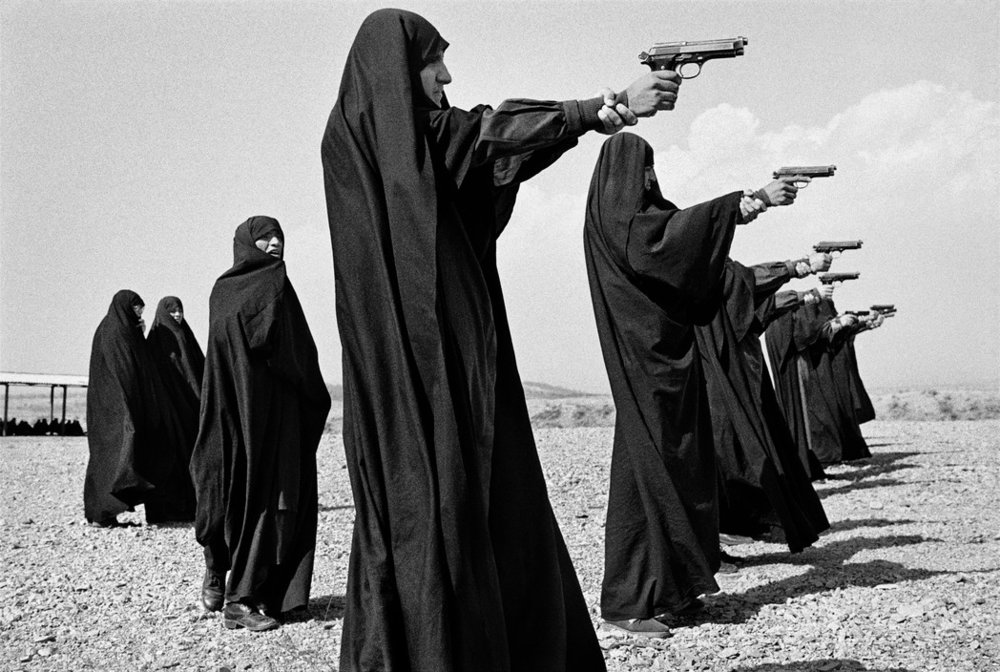 Veiled women practice shooting on the outskirts of the Tehran, Iran. Photo by Jean Gaumy 1986.