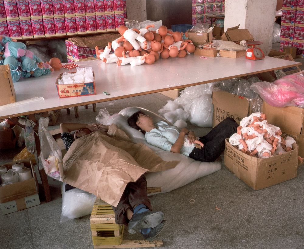 Workers taking a break at a toy factory. In recent years China has grown to become the world's fifth largest exporter of merchandise, and has one of the world's fastest growing economies. A huge influx of migrant workers is required to meet demand in city factories. Photo by Michael Wolf.