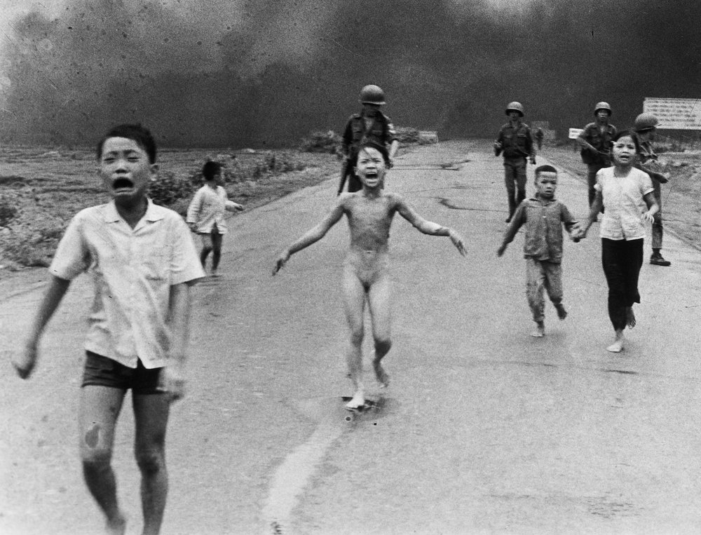 Phan Thi Kim Phuc (center) flees with other children after South Vietnamese planes mistakenly dropped napalm on South Vietnamese troops and civilians. Photo by Nick Ut.