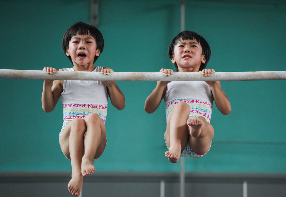 The twins' gymnastics dream This series was taken in a sports school in Jining, in Shandong province, China. Liu Bingqing and Liu Yujie are twin sisters, who have liked gymnastics since their childhood. They have studied, trained and grown up here. Photo by Yuan Peng.