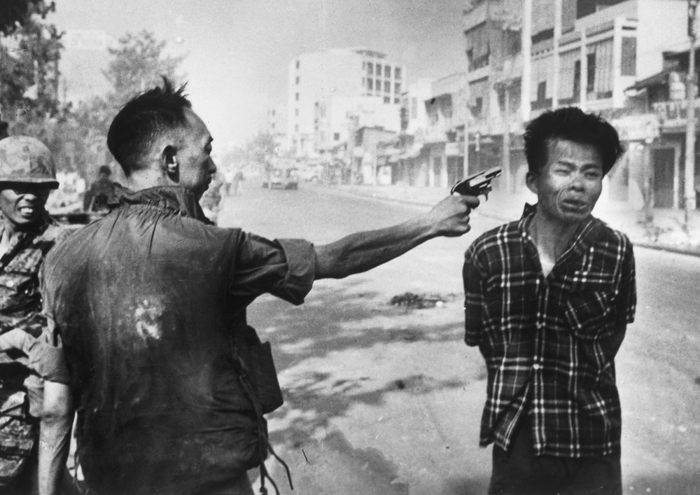 Saigon, Vietnam. South Vietnam National Police Chief Nguyen Ngoc Loan executes suspected Viet Cong member Nguyen Van Lem, on the second day of the Tet Offensive during the Vietnam War. Photo by Eddie Adams.