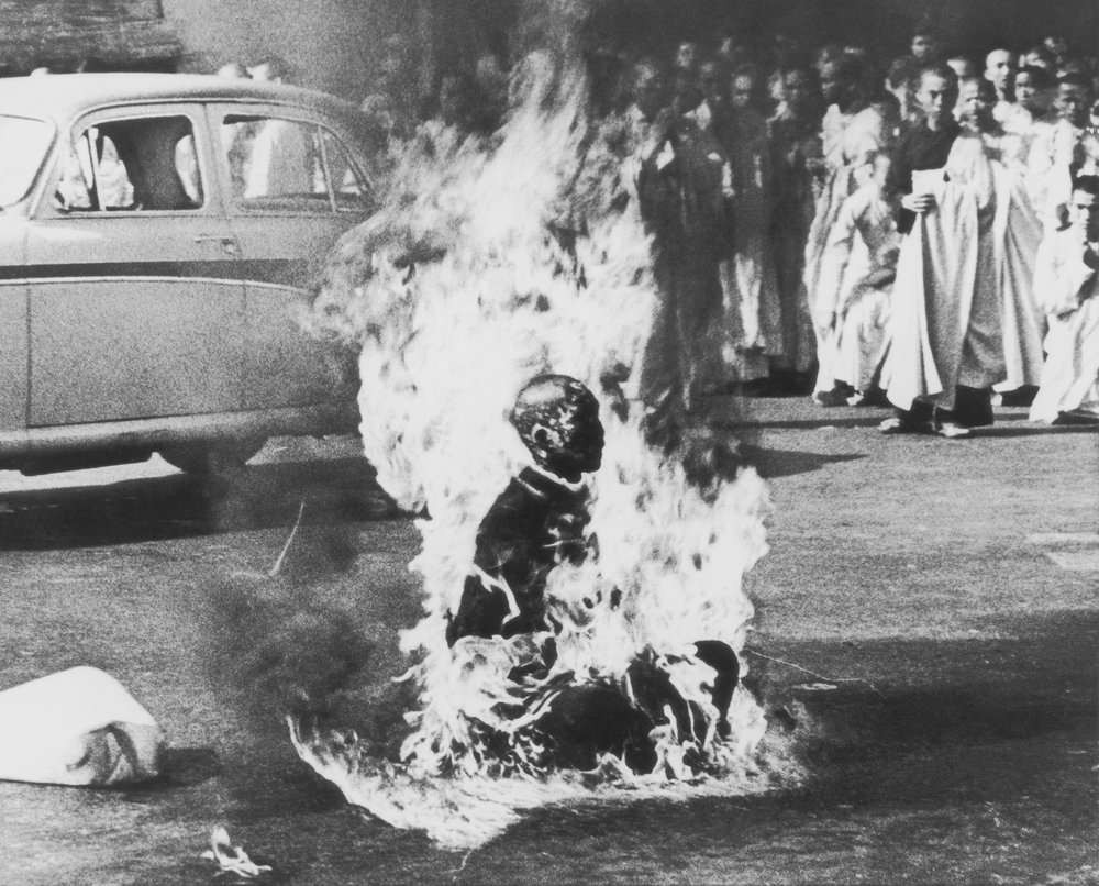 Saigon, Vietnam Buddhist monk Thich Quang Duc sets himself ablaze to protest the South Vietnamese government's persecution of Buddhists. The self-immolation of Thich Quang Duc occurred during the Buddhist crisis in Vietnam, the civilian upheaval against the predominantly Catholic government of President Ngo Dinh Diem, which was supported by the United States. Photo by Malcolm W. Browne.
