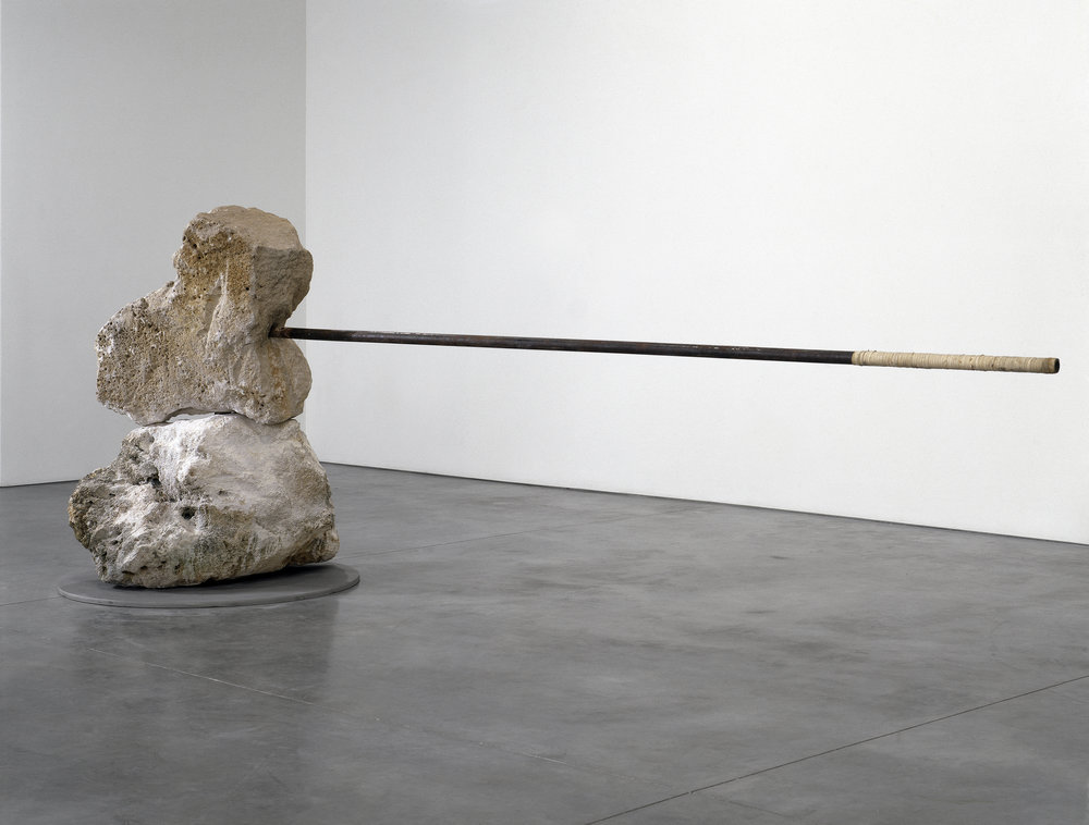 Janine Antoni,  And , 1996-99.  Two 800 lb. limestone boulders, stainless steel rod and base © Janine Antoni; Courtesy of the artist and Luhring Augustine, New York