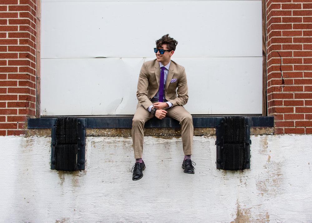 Jason posing for his Ties.com Style Guru Society photos.