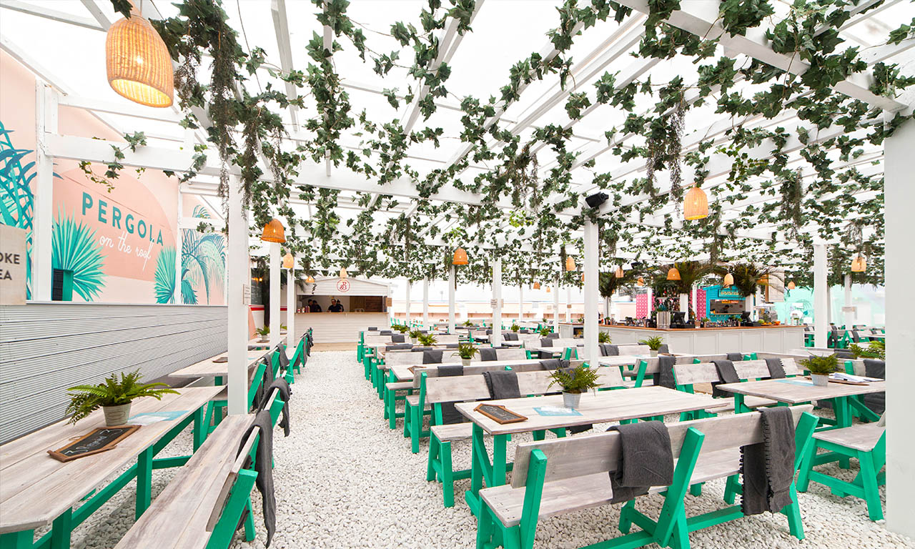 600 seats, five 13-person day beds, self-service dining, summer tunes and a roof in case of rain, we (quite literally) have everything covered. This summer, Pergola on the Roof is taking London on a road trip to the East Coast of the USA. 3rd May - 1st October 2017 Our flooring is a little pebbly! We advise you don't wear heels or suede shoes.