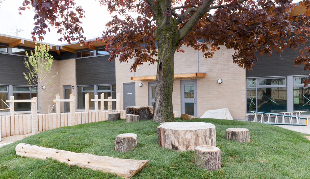 Dane Avenue Child Care Centre Natural Play Space - Client: City of Toronto - Toronto, Ontario - 2014-2017 - Collaborators: DTAH - Credit: DTAH  I designed, detailed and project managed this naturalized play space for infants to preschool-age children from concept to bid documents. Starting with precedents research and visioning, this design met the client's mandate for natural materials, sensory experiences and development of early motor skills, stringent national codes on playground design as well as stormwater management and tree planting and preservation requirements in a play space approximately 600 square yards for 50 children. The budget and future maintenance were the design constraints and I had to strategize on how best to achieve the project program and goals by simplifying the material palette while strengthening the design.