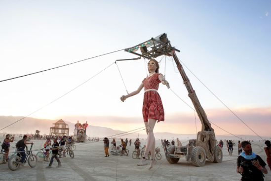 Miguel Angel Martin Bordera,  Stepping Forward , an over 20-foot-tall marionette that moves about Black Rock City at Burning Man 2017. Courtesy of the Burning Man Journal/John Curley