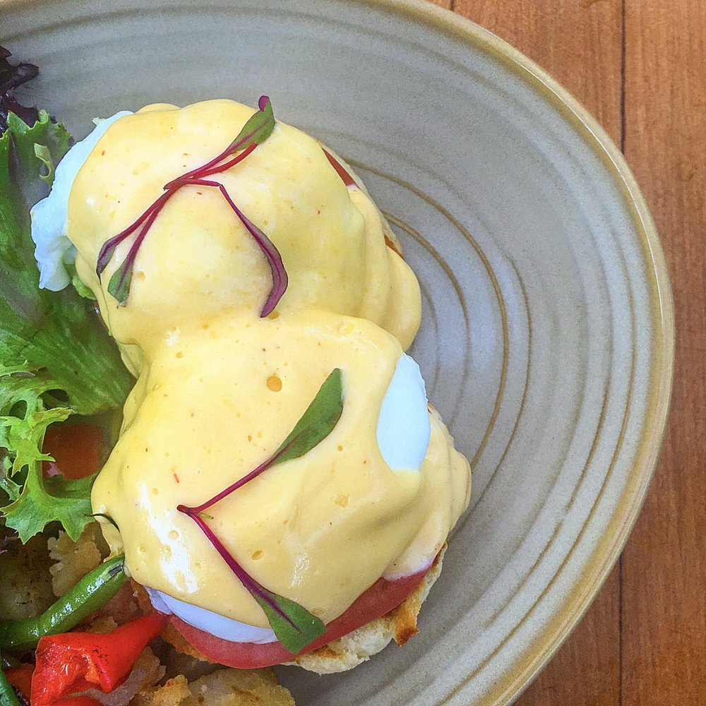 California Eggs Benedict with buttermilk biscuits, avocado, tomato, hollandaise & potato hash at Terrain Garden Cafe in Westport, CT