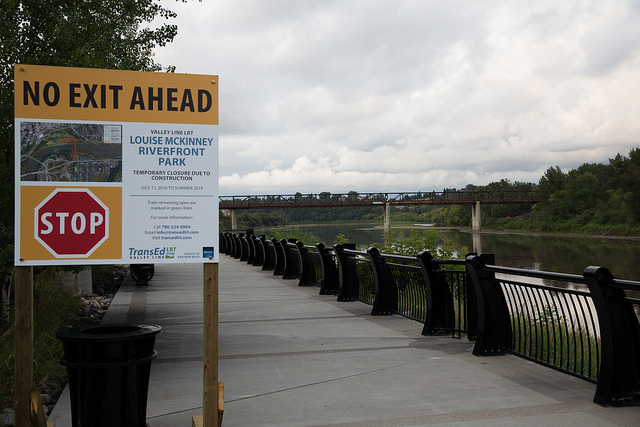 The all-too common sign you face when you're on your feet in Edmonton. This one is because the Cloverdale Footbridge was to be removed. At least that means LRT. But the barriers are everywhere in Louise McKinney Park and the walk path detours are not. Photo: Flickr/Mack Male