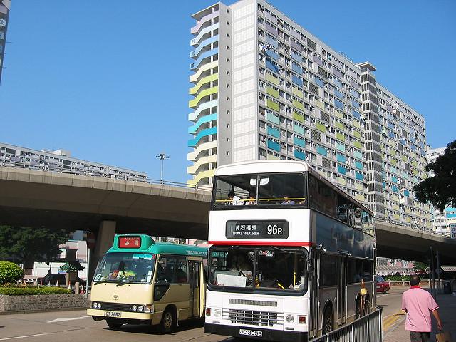 Private mini-bus beside public bus, Hong Kong. Photo: Flickr/Yuksing