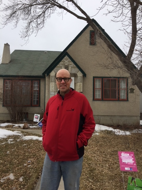 Scott Rollans in front of his house in Central McDougall/Tim Querengesser