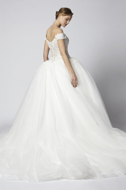 0fdb9da7e85 Ivory Nude off the shoulder short sleeve tulle and lace ballgown.  Corseted