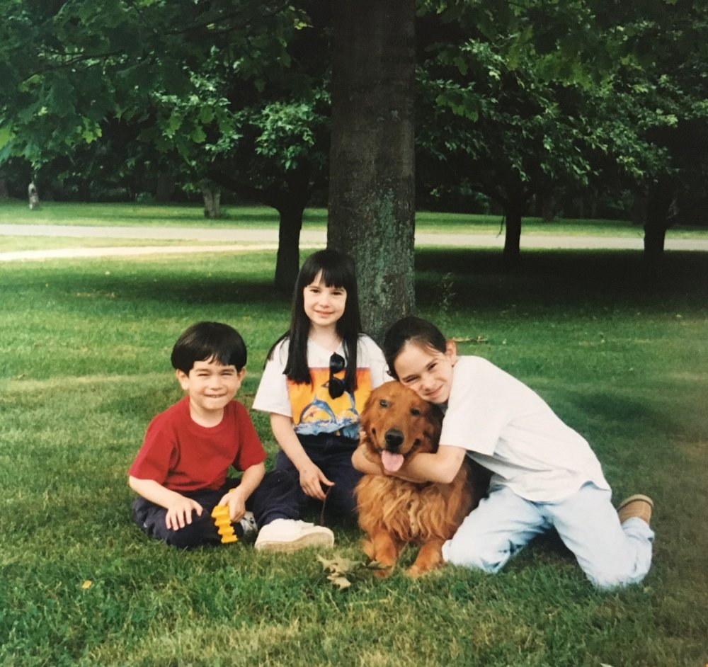 My siblings and I with our dog, Lily, during the pig farm years