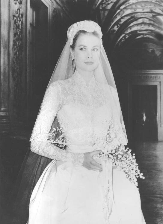 abc7769369c9 ... Kelly is the epitome of old Hollywood glamour, and she became royalty  when she wed Prince Rainer III of Monaco in one of the most iconic wedding  dresses ...