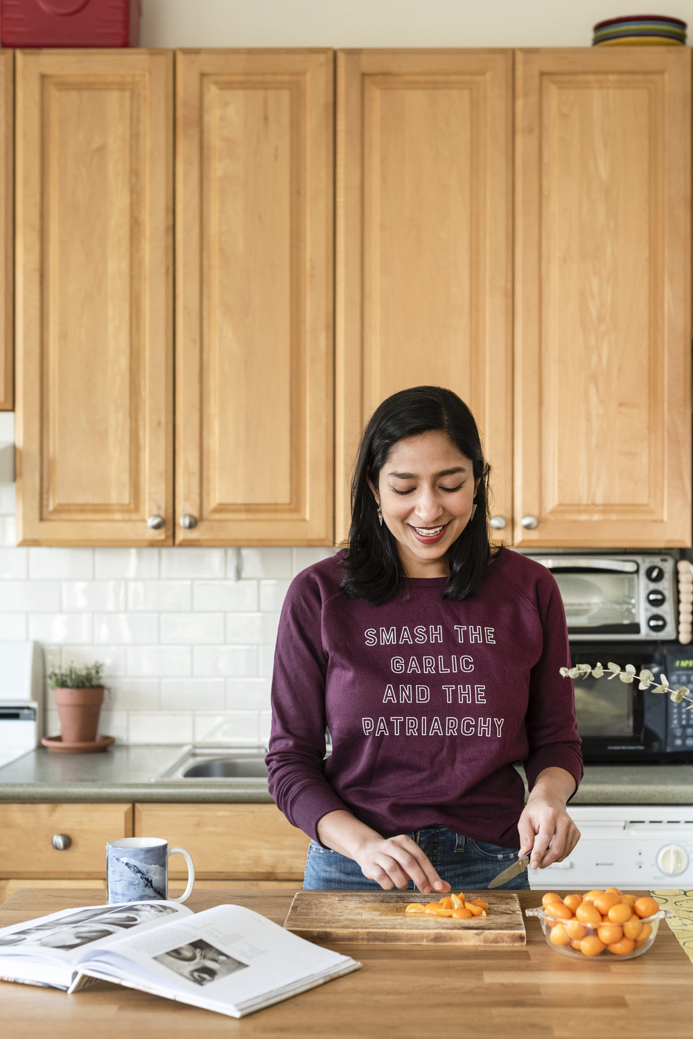 Priya in her home kitchen in Brooklyn, photographed by Liz Clayman