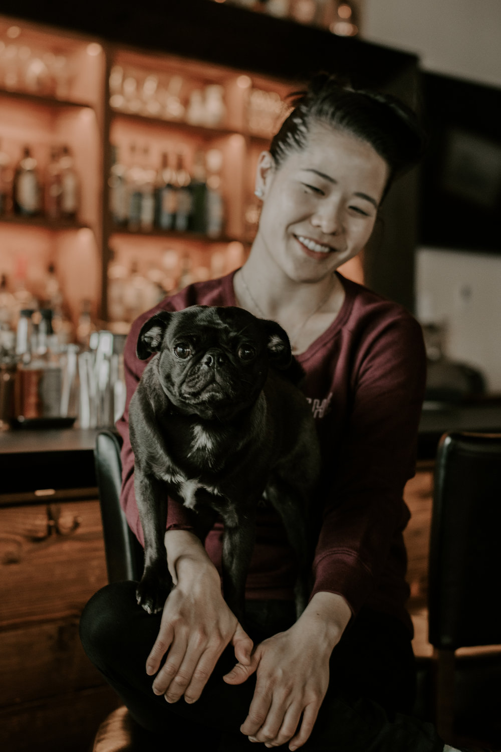 Tracy Chang in her restaurant PAGU with her pug Pearl. Photograph by Sarah Hummel