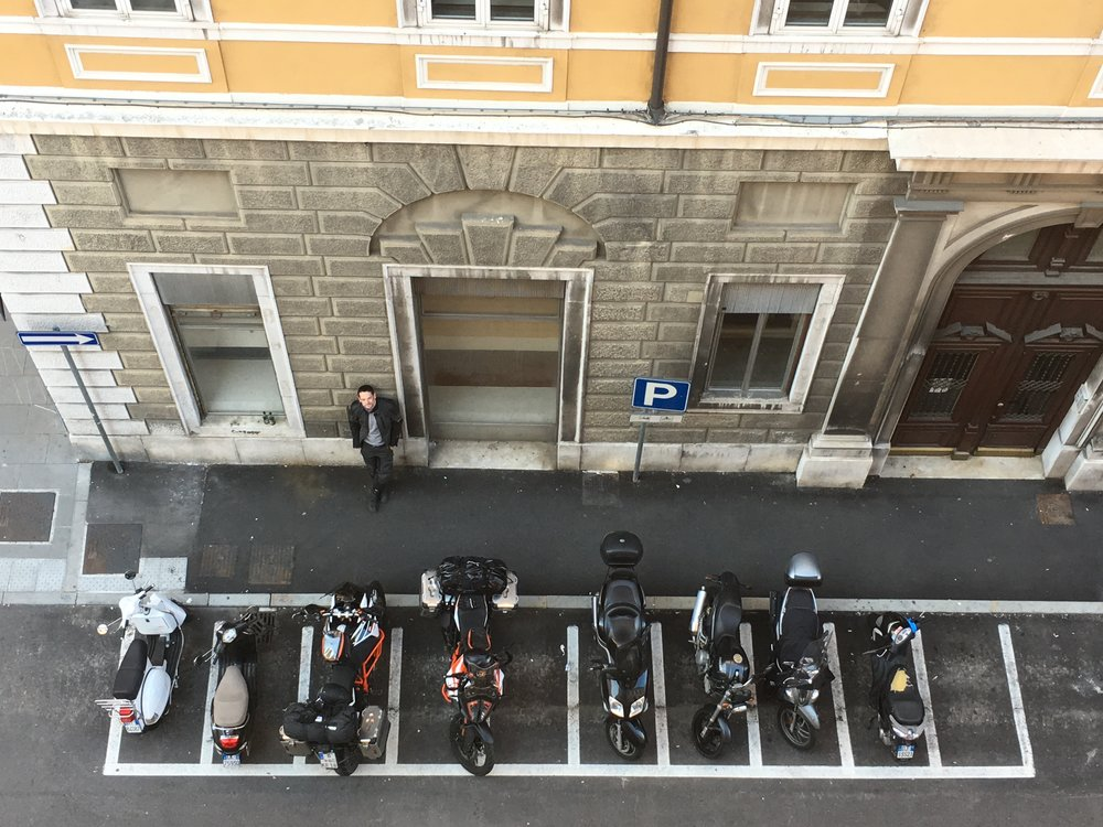 Motorcycle parking areas in the city center. Bravo, Italy!