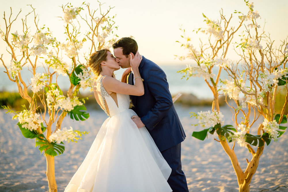 First Kiss beach wedding photo.jpg