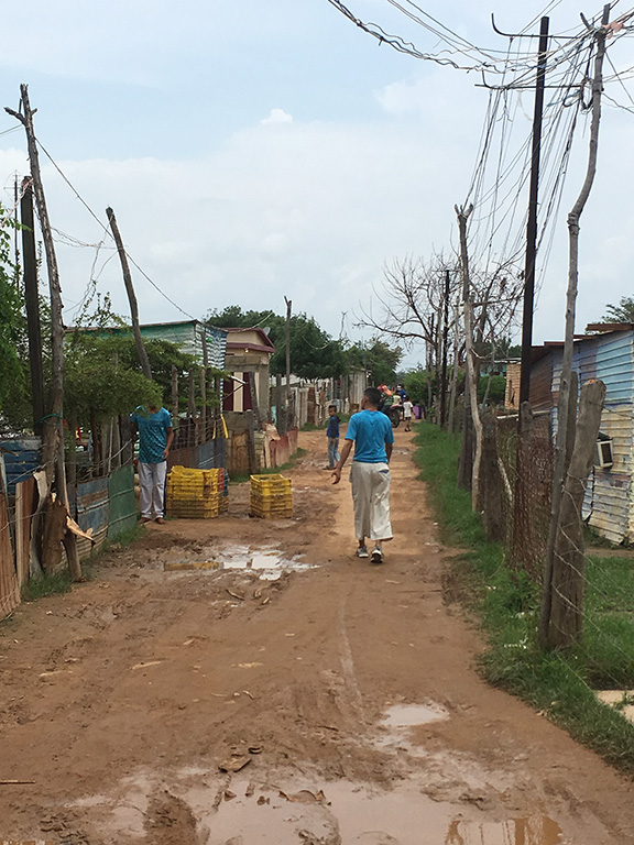 Barranquitas, Maracaibo. It is estimated 30% of the town's 12,000 or so inhabitants are affected by Huntington's disease. Few families lack a history of the disease. Most of HD families are very poor and have illegally occupied land that floods when it rains. Stagnant water, lack of sewage treatments, and lack of proper nutrition leads to severe health issues for these people.