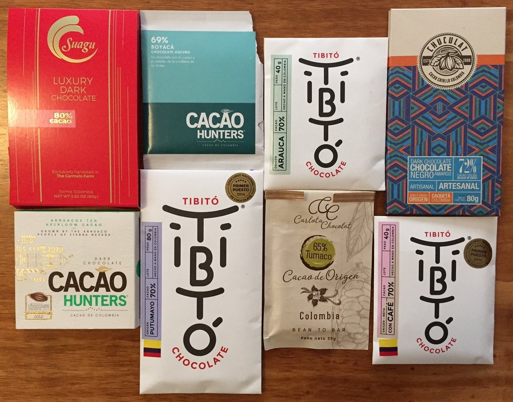 A typical selection of Colombian single-region and single-estate chocolates offered in a Colombian Chocolate Club tasting. Includes chocolate made from cacao grown in Tolima, Boyaca, Arauca, Caquetá, Sierra Nevada de Santa Marta, Putomayo, Tumaco and Meta.