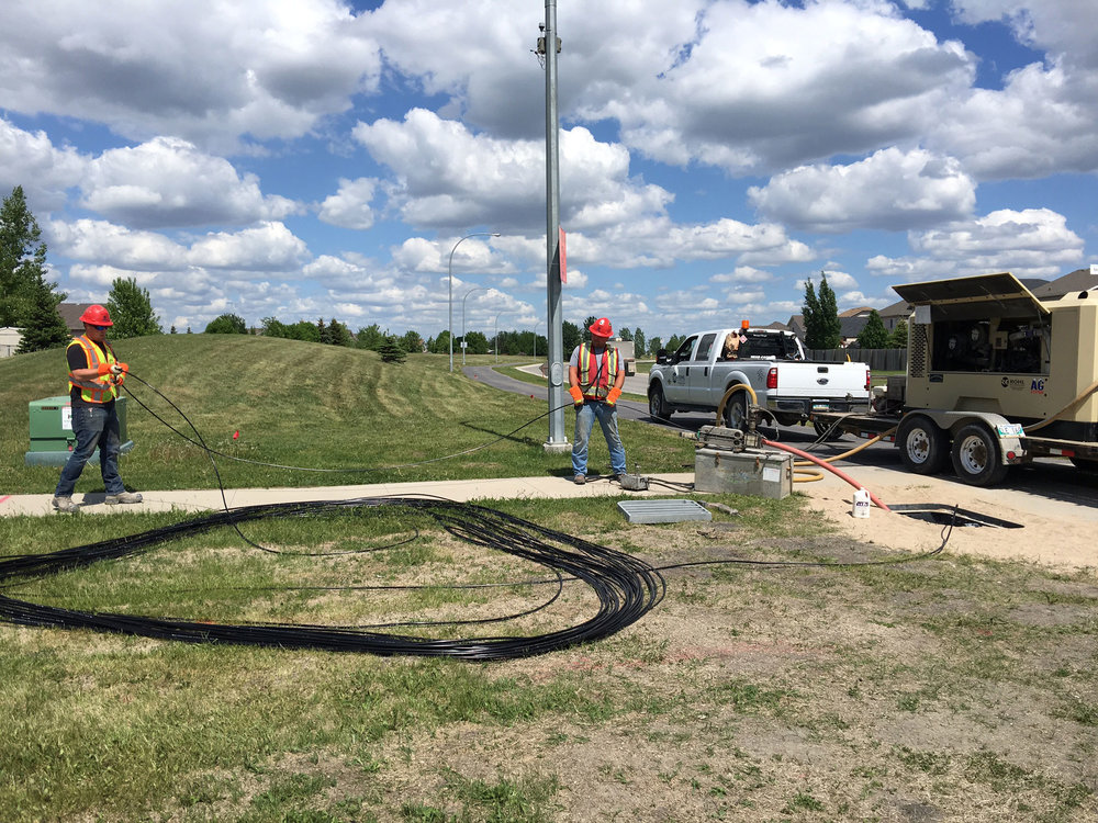 "Cable Jetting - Primarily used for installing fibre optic cable, our specialized ""jet"" equipment enables us to use air, along with lubricants, to safely blow cable through conduit.  This allows for longer installation distances while exerting less force on cables and reducing cable handling."