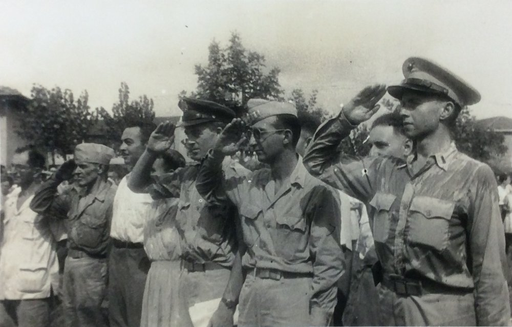 Officers of AGAS salute Allied civilians liberated from Japanese prison camps in Shanghai, August 1945