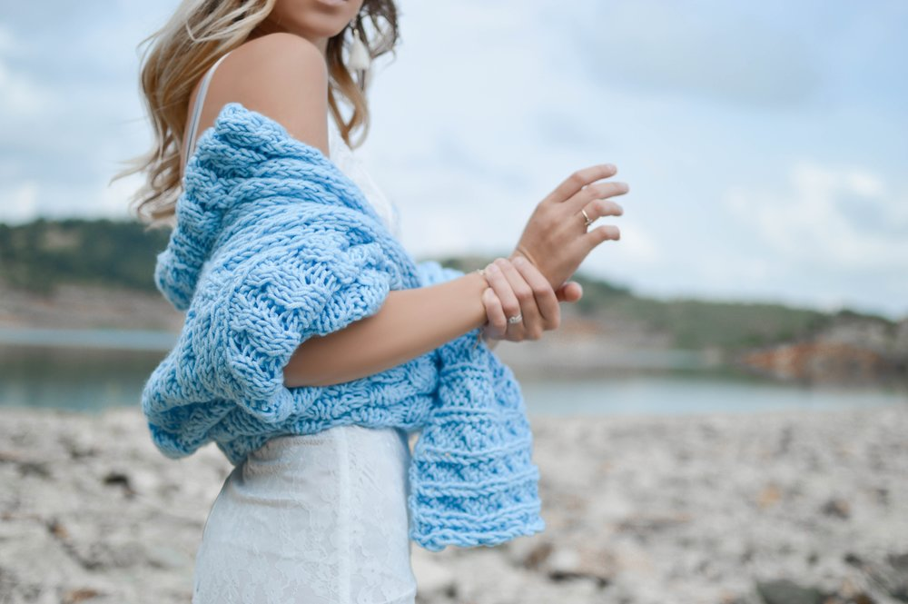 bright blue sweater and white skirt
